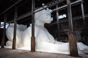 "Kara Walker's Exhibit, ""A Subtlety"" or ""The Marvelous Sugar Baby"" can be seen Saturdays & Sundays between 11am-6pm at the  Domino Sugar Factory in the Williamsburg neighborhood of Brooklyn."